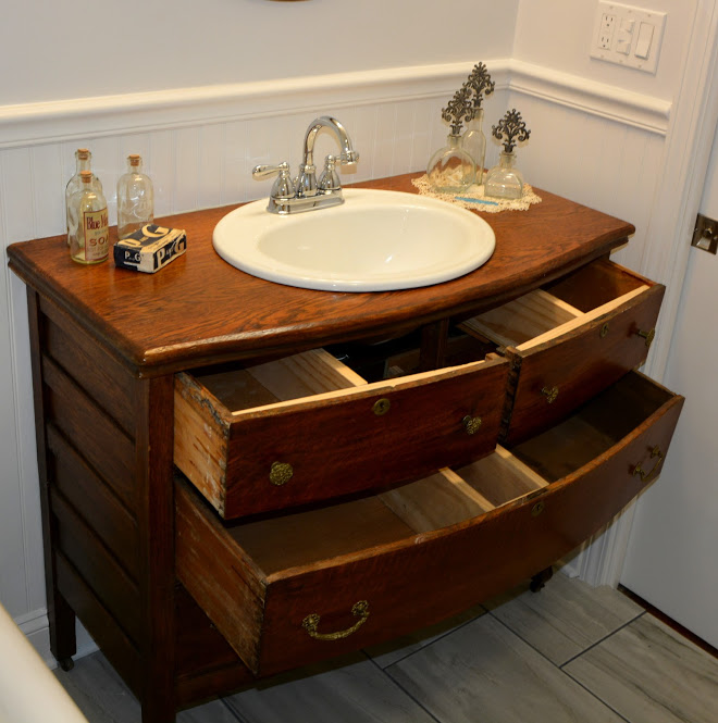 This Bathroom Remodel We Added A Re Purposed Antique Dresser That Was Customized Into Sink Vanity To Allow Moen And Chrome Faucet