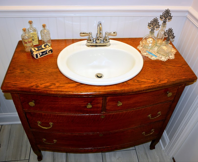 This Bathroom Remodel We Added A Re Purposed Antique Dresser That Was  Customized Into A Sink Vanity To Allow A Moen Sink And Chrome Faucet.