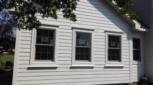 Repaired the woodr rot damage and then Installed Hardie lap siding and Quaker Windows