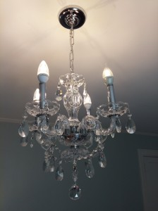 A crystal chandelier with LED bulbs gives an elegant look in your Master Bedroom