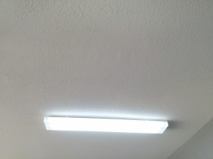 4' Florescent light fixtures were installed in this garage to brighten it up